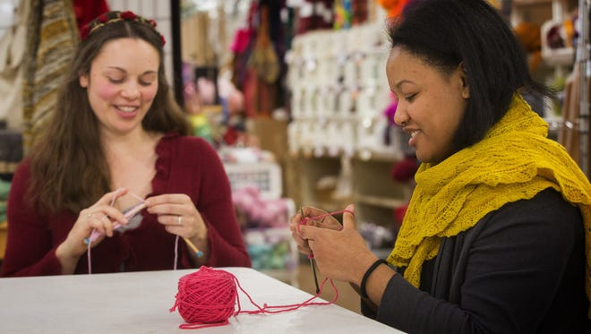 Jennifer Miller, left, a yarn wrangler, and Jessica Owens, manager of Weaving Works in Seattle, Wash. get started on knitting Pussyhats for women to wear at the Women's March on Washington.