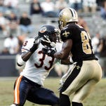 Former UL standout Charles Tillman, left, faces off against Joe Horn of the New Orleans Saints in this 2005 file photo.