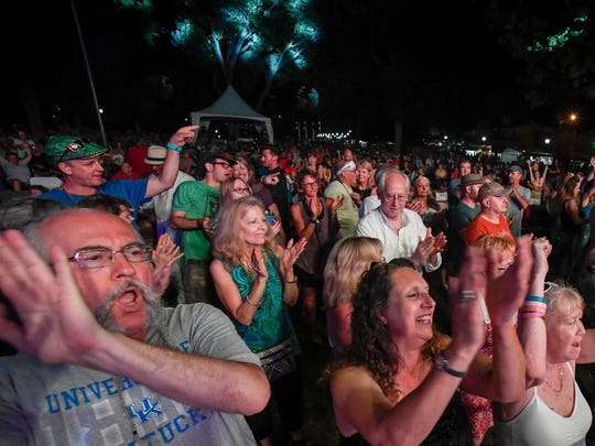 Blues fans listen to guitarist Coco Montoya on stage as the final act of the 2017 W.C. Handy Blues and Barbecue Festival Saturday, June 17, 2017.