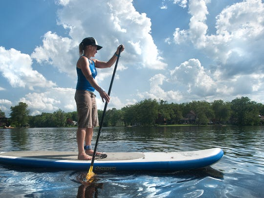 Margo Pellegrino paddles near her home at Upper Aetna Lake in Medford Lakes.