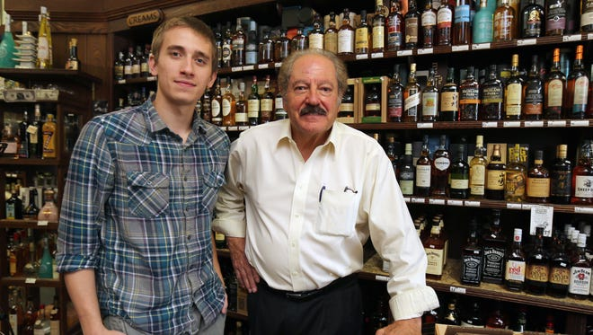 Tony Russo, right, owner of the Aries Wines and Spirits on West Post Road in White Plains stands with assistant Evan Amadio at the store, Sept. 17, 2015. Under a law that passed last year, all liquor stores and other types of businesses had to install security cameras and share the video with police if needed.