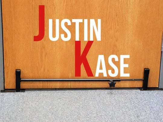The steel-plate-and-rods door barricade developed by Justin Rivard, a high school senior in Somerset, Wis.