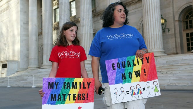 Protesters called for marriage equality outside the federal courthouse in Denver during oral arguments in April.
