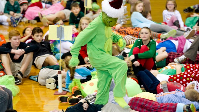 """Isaac Holland, 13, portrays the Grinch during rehearsal for Holy Name School's production of """"How the Grinch Found Christ in Christmas."""""""