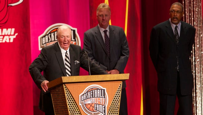 Aug 8, 2014; Springfield, MA, USA; ABA coach Bob Leonard is inducted into the Basketball Hall of Fame by presenter Hall of Fame players Mel Daniels (â??12) and Larry Bird (â??98) during the 2014 Naismith Memorial Basketball Hall of Fame Enshrinement Ceremony at Springfield Symphony Hall. Mandatory Credit: David Butler II-USA TODAY Sports