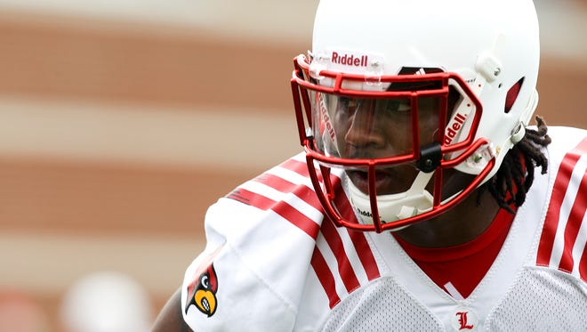 Linebacker Keith Brown watches his coach during drills at practice. August 5, 2014