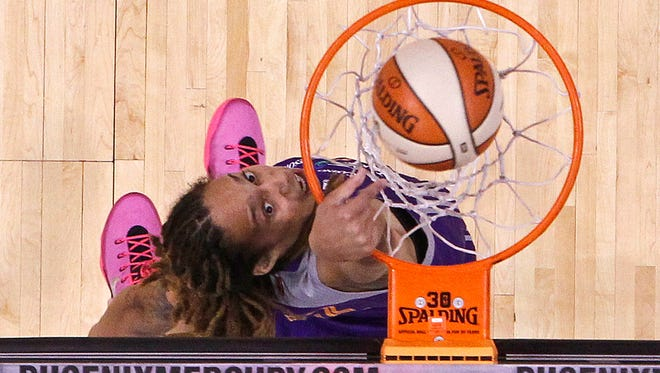 The West's Brittney Griner dunks against the East during the  WNBA All-Star Game Saturday, July 19, 2014 in Phoenix, Ariz.