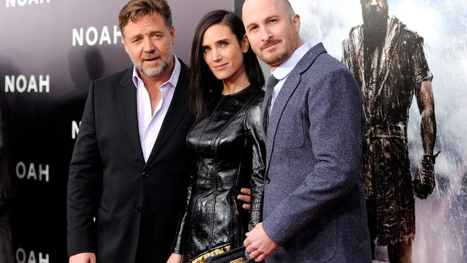 """Actors Russell Crowe, left, and Jennifer Connelly pose with director Darren Aronofsky at the premiere of """"Noah,"""" at the Ziegfeld Theatre on March 26, 2014, in New York."""