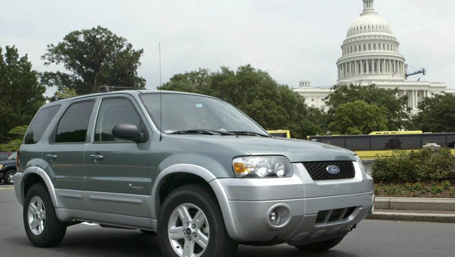 A Ford employee drives the Ford Escape Hybrid SUV in  Washington, D.C.