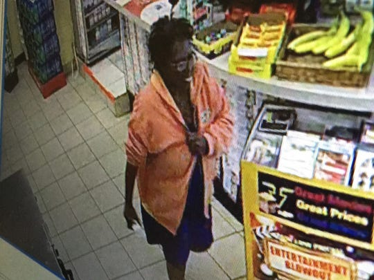 Surveillance video depicts the woman suspected of using a 70-year-old's card illegally.