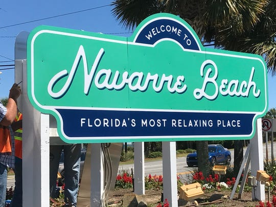 "A temporary ""Welcome to Navarre Beach"" sign is erected"