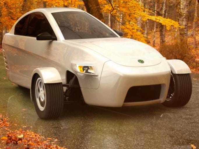 The Elio as seen on a country road, a three wheel car designed to sell for $6,800 and get 84 miles per gallon on the highway