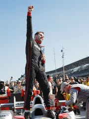 Team Penkse IndyCar driver Will Power (12) celebrates his winning the IndyCar Grand Prix Saturday, May 13, 2017, afternoon at the Indianapolis Motor Speedway.
