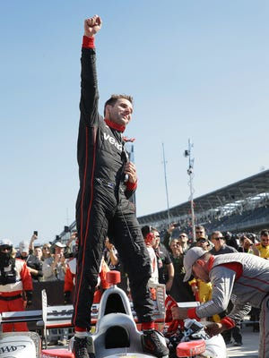 Team Penske IndyCar driver Will Power (12) celebrates his winning the IndyCar Grand Prix Saturday, May 13, 2017, afternoon at the Indianapolis Motor Speedway.