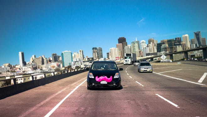Lyft's mobile app allows users to make transportation arrangements -- just name your location and your pink-mustached vehicle will pick you up.