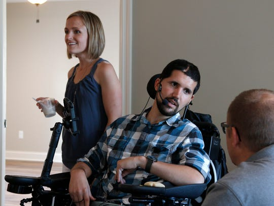 Emily, left, and Lane Bargeron talk with guests at