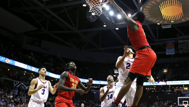 Oak Hill Academy forward Mario Kegler (4) dunks the ball during third quarter action of the 2016 Tournament of Champions semifinal game between Oak HIll Academy (Mouth of Wilson, Va.) and Rainier Beach High School (Seattle, Wash.) at JQH Arena in Springfield, Mo. on Jan. 15, 2016.