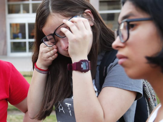 Darian Cruz wipes away a tear while standing next to Vanessa Gonzalez during a rally at the Arizona State Capitol in Phoenix on April 9, 2018.. The State Supreme Court denied in-state tuition for DACA recipients. Cruz is an undocumented immigrant and a senior in high school.