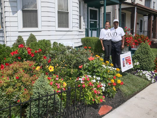 Retired New Brunswick Police Officer Jim Neal and his wife, Debbie Neal, on Aug. 25, 2016. The Neals have dedicated a garden at their Joyce Kilmer Avenue home to Dr. Martin Luther King Jr.