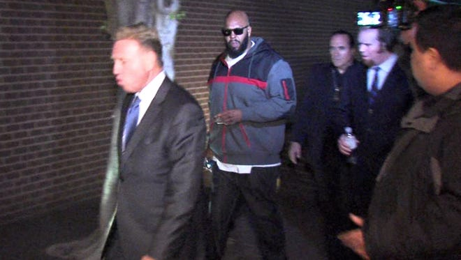 "This image from video shows Death Row Records founder Marion ""Suge"" Knight, right, walking into the Los Angeles County Sheriffs department early Friday morning Jan. 30, 2015 in connection with a hit-and-run incident that left one man dead and another injured."