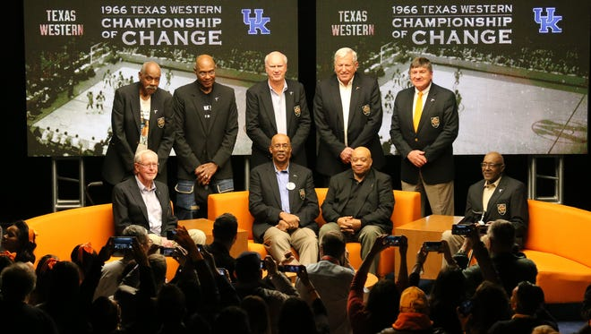 Members of the 1966 Texas Western Men's Division 1 NCAA National Basketball Championship team pose after filming a panel discussion for CBS Sports that looked back at the championship game against Kentucky. Standing from left are Willie Cager, David Latin, Dick Myers, Jerry Armstrong and Togo Railey. Sitting from left are Louis Baudoin, Nevil Shed, Willie Worsley and Orsten Artis.