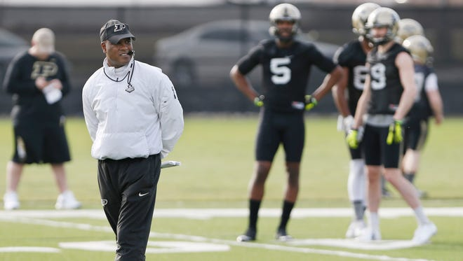 Head coach Darrell Hazell watches his players run through drills during spring football practice Tuesday, March 8, 2016, at Purdue University.