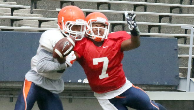 UTEP quarterback and receiver Kavika Johnson, 7, collides with a UTEP defender in the end zone Saturday in Sun Bowl Stadium.