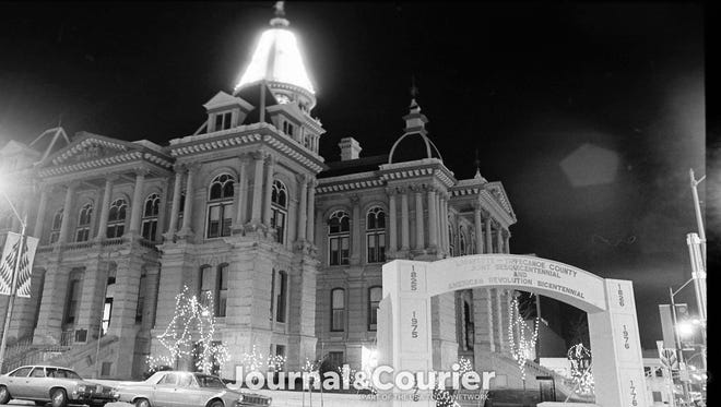 The Tippecanoe County courthouse dome shines brightly for the holiday season in downtown Lafayette. Photo taken Dec. 2, 1975.