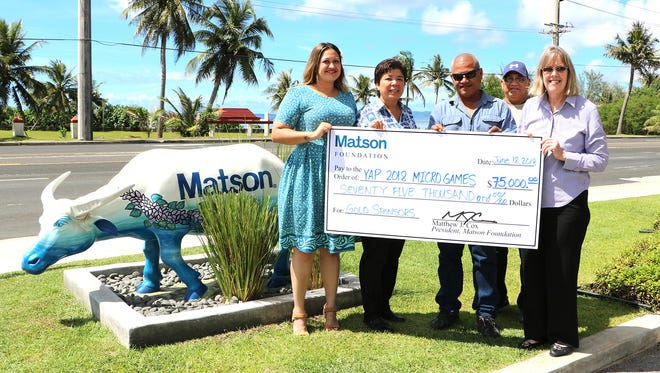 Matson presents a check for $75,000 to Liyon Sulog, CEO and co-chairman of the 2018 Micronesian Games Organizing Committee as part of its gold sponsorship, in partnership with Triple B Forwarders and Palau Shipping. From left: Tasi Peddicord, Matson regional manager, sales and customer service; Bernie Valencia, Matson vice president and general manager, Guam and Micronesia; Sulog; Lukas Ruuemau, Pacific Bus Company CEO and Micronesian Games representative; and Prudence Denight, Matson account executive.