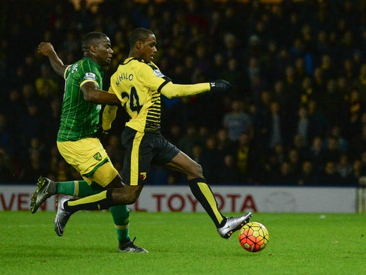 Watford's Odion Ighalo, right, scores his side's second goal as Norwich City's Sebastien Bassong attempts to challenge during their English Premier League soccer match at Vicarage Road, Watford, England, Saturday, Dec. 5, 2015. (Jon Buckle/PA via AP)     UNITED KINGDOM OUT     -     NO SALES    -     NO ARCHIVES