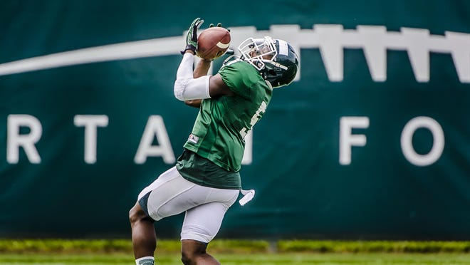 """MSU receiver DeAnthony Arnett said that if he has a great senior season, """"It will be one heck of a story. One hell of a story. We all know that."""" The one-time top recruit out of Saginaw High caught 24 passes for 242 yards and two touchdowns as a true freshman at Tennessee in 2011 but has just six catches for 87 yards in 12 games the past three seasons for the Spartans."""