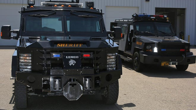 Two BearCat military armored vehicles sit in the parking lot of the Franklin County SWAT facility in Columbus in 2015.