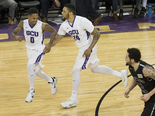 GCU's Keonta Vernon (24) celebrates with DeWayne Russell