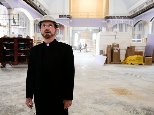 Rev. Steven LeBlanc looks over construction in the new St. Pius X Church in Lafayette Tuesday, April 18, 2017.