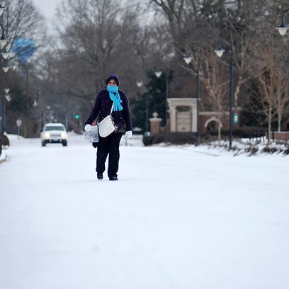 Cleo Driver walks down an ice covered University Avenue