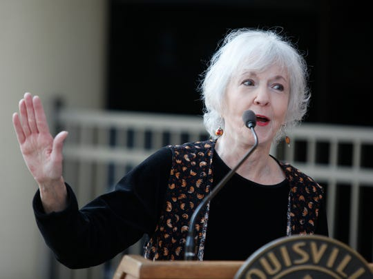 Louisville born author Sue Grafton makes a point during a short speech before viewing a banner in her honor on the side of a downtown Louisville hotel. April 20, 2106.
