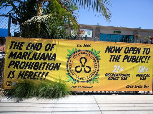 Signage is seen outside of the California Compassionate