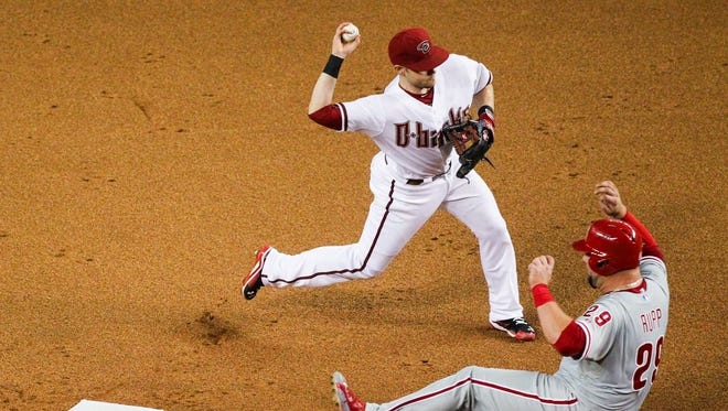 Arizona Diamondbacks second baseman Chris Owings (16) forces out Philadelphia Phillies catcher Cameron Rupp (19) at second and throws to first to complete a double play and end the top of the 7th inning at Chase Field on Tuesday, August 11, 2015, in Phoenix, AZ.