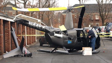 The FAA investigates after a Friday night helicopter hard landing in an apartment complex parking lot off Main Street in Chatham  February 25, 2017, Chatham, NJ.