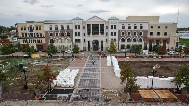 Work crews construct an ice rink on Center Green at the Center for the Performing Arts in Carmel Ind. on Monday, Oct. 30, 2017. The rink will set between the The Palladium, The Tarkington, and Studio Theater.