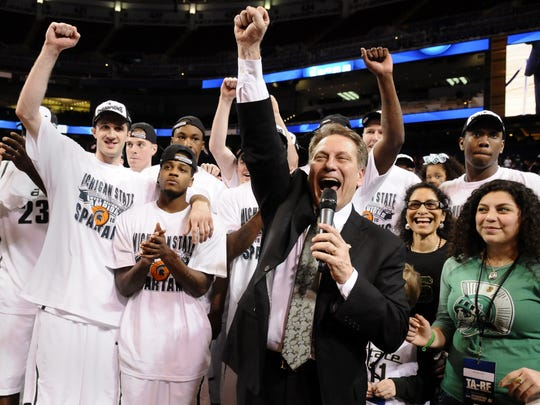 MSU head coach Tom Izzo thanks his team and the fans as The Spartans celebrate their 70-69 victory over Tennessee Sunday in their NCAA Midwest Regional  3/28/10. (photo by Rod Sanford)