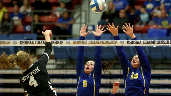 Nickerson's Josie McLean (9) and McKinzie Starnes (18) attempt to block Holton's spike during the 4A state volleyball tournament at the Sports Arena.