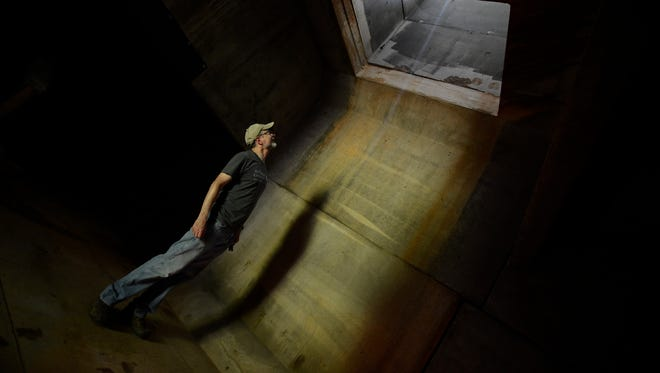 Paul Kingsbury stands inside the artificial bat cave looking up where bates fly into the cave from the outside on private property in Montgomery County on Friday, July 11, 2014, in Clarksville, Tenn. The artificial bat cave is a healthy home for endangered bats.