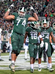 MSU offensive tackle Jack Conklin (74) and wide receiver Aaron Burbridge (16) are both expected to be selected in this week's NFL draft. Among others, the Spartans will have to replace their left tackle and a receiver who caught a school-record 85 passes last season.