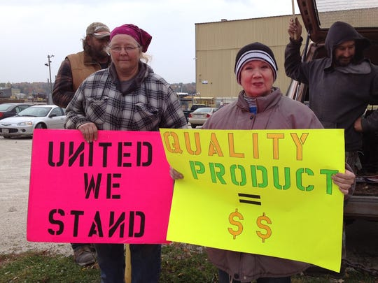 Welders Diane Tipler, left, and Lylian Nielson, who work at Bay Shipbuilding in Sturgeon Bay and belong to Boilermakers Union Local 449, take part in an informational picket outside the shipyard Thursday. The contract between the union and the shipyard expired Sept. 12 and is now in negotiation.