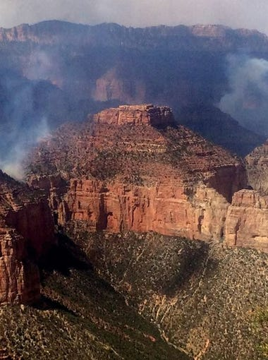 Smoke rises above the North Rim of the Grand Canyon.