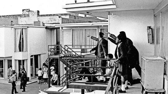 Martin Luther King Jr. is laid on a balcony after he