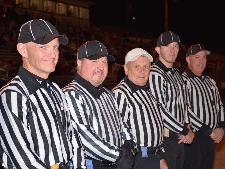Curtis Dowdle (left), who is Southwestern Community College's dean of public safety training, serves as an official for high school football games each fall.