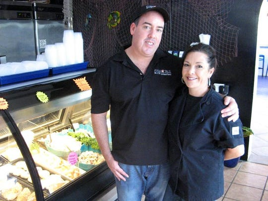 Patrick and Kerry Krieg pose at Merrick Seafood. They recently added the restaurant Fish Tale Grill by Merrick Seafood to the Cape Coral company's seafood market and wholesale operations.