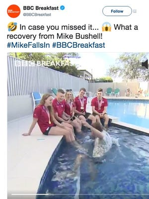 A BBC journalist accidentally fell into a swimming pool during a hilarious live interview with the British swim team.
